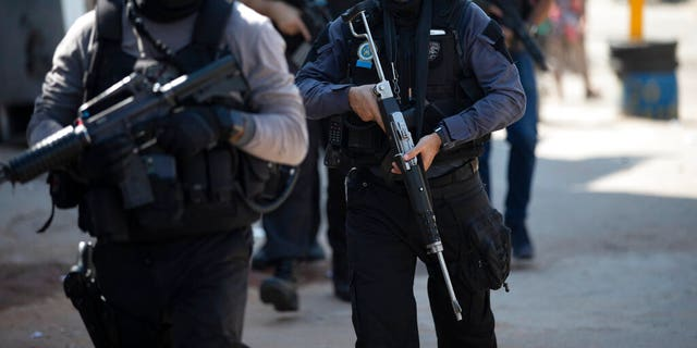 Police conduct an operation against alleged drug traffickers in the Jacarezinho favela of Rio de Janeiro, Brazil, Thursday, May 6, 2021.